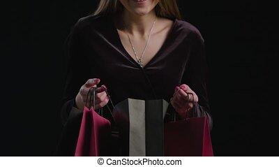 Woman Black Friday Shopping - Happy woman open black bag on...