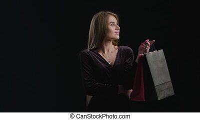 Woman Black Friday Shopping - Sale. Young smiling woman...
