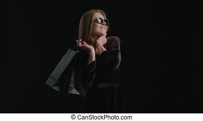 Woman Black Friday Shopping - Woman in cool sunglasses and...