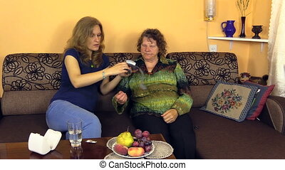 woman blood pressure - nurse woman put on the grandmother...