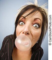 Woman blowing a bubble