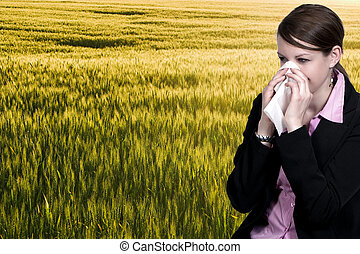 Woman Blowing Her Nose - A beautiful woman with a cold, hay...