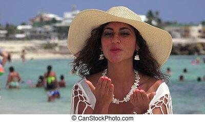 Woman Blowing Kisses And Waving At Beach