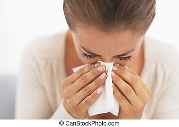 Woman blowing nose into handkerchief - Closeup on pills pack...