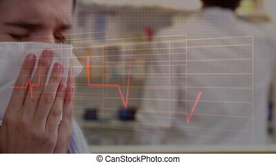 Woman blowing nose over a heartbeat monitor in the ...