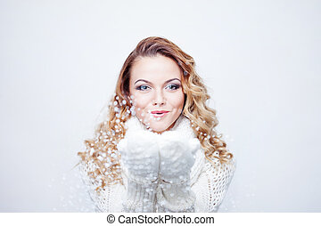 Woman Blowing Snow, girl in  warm knitted scarf and gloves, portrait on  white background, place for your text