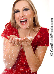 Woman blowing soft flakes