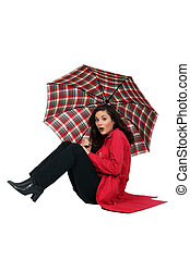 Woman blown over with her umbrella