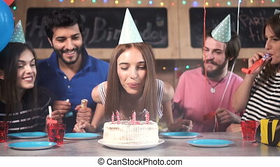 Woman Blows Birthday Candles