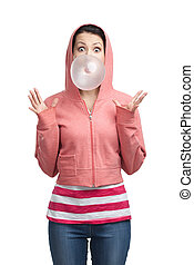 Woman blows out bubble gum - Woman in sweatshirt blows out...