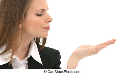 Woman blows something from her hand with copy space above her hand