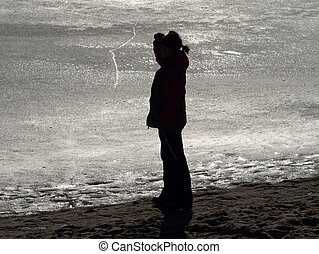 Woman body outline in strong light from frozen lake.