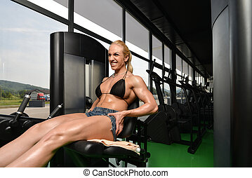 Woman Bodybuilder Doing Exercise For Legs