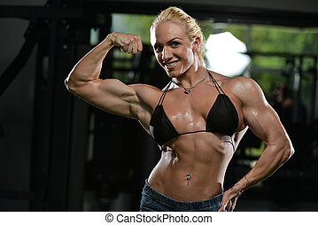 Woman Bodybuilder Flexing Muscles - Serious Woman ...