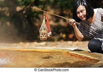 Woman boiling eggs