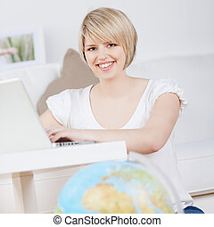 Woman booking her holiday online