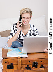 Woman booking her holidays over the internet