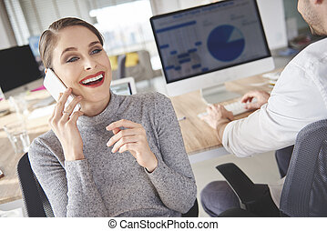Woman booking meetings with customers by the phone