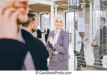 Woman boss talking with client