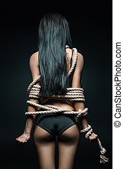 woman bound with rope