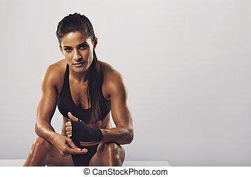 Woman boxer getting ready for workout - Woman boxer wearing...