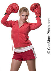 Portrait of a blond woman wearing red sports attire with matching boxing gloves over white