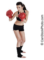 Woman boxer ready to punch the opponent in boxing