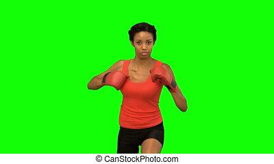 Woman boxing on green screen