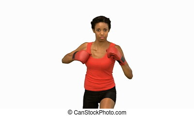Woman boxing on white screen in slo