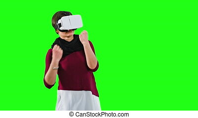 Woman Boxing with a VR Headset On.