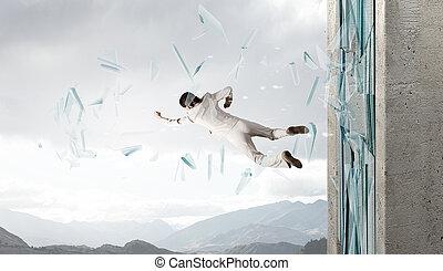 Woman breaking through glass