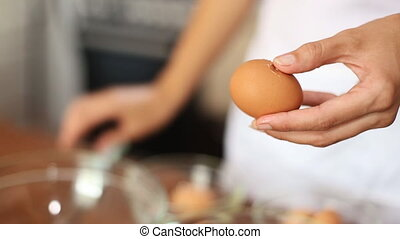 Woman breaks an egg - Womawoman breaks separating the egg...
