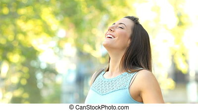 Woman breathing fresh air in the street