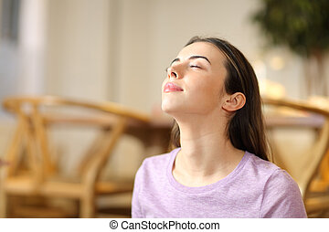 Woman breathing fresh air relaxing at home
