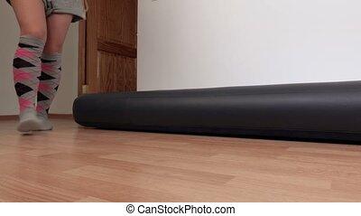 Woman bring pump and put near to the air mattress