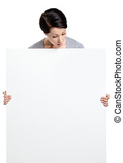 Woman brings a huge sheet of white cardboard