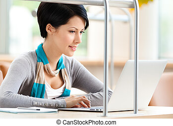 Woman browsing on the laptop