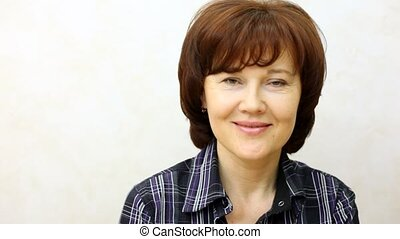 Woman-brunette of average years smiles