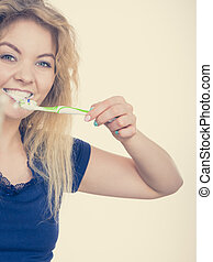 Woman brushing cleaning teeth