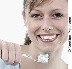 woman brushing her teeth, studio white