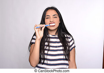 Woman brushing her teeth. - Close-up woman brushing her...