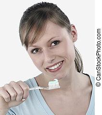 woman brushing her teeth,