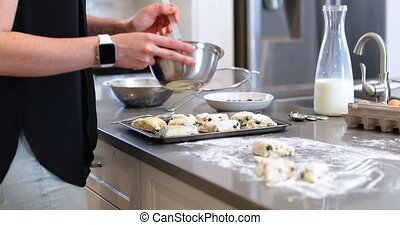 Woman brushing oil on cookie dough in kitchen4k - Woman...