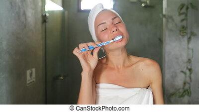 Woman Brushing Teeth In Bathroom, Cheerful Beautiful Girl In...