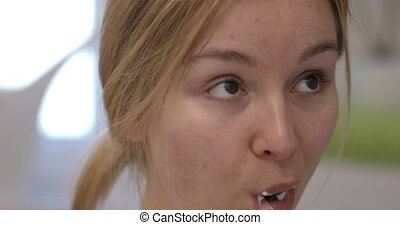 Woman brushing teeth on slowmotion - Portrait of a young...