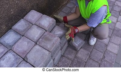 Woman builder near bricks at outdoor
