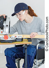 woman builder on the wheelchair