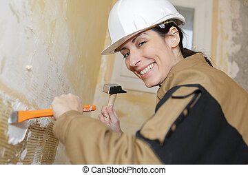woman builder plastering the wall