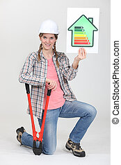 Woman builder showing energy rating sign