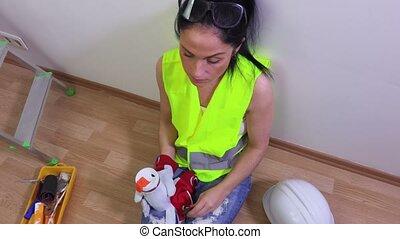 Woman builder take coffee break